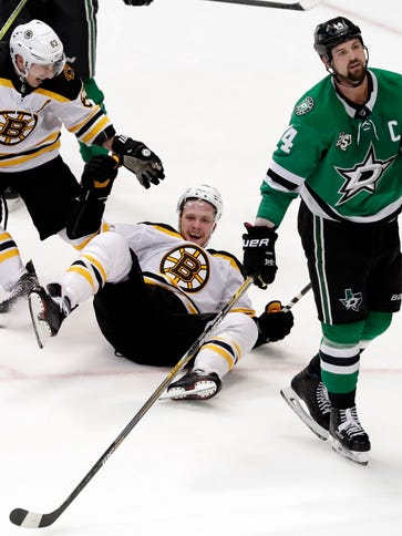 Bruins forward Brad Marchand (63) skates over to celebrate