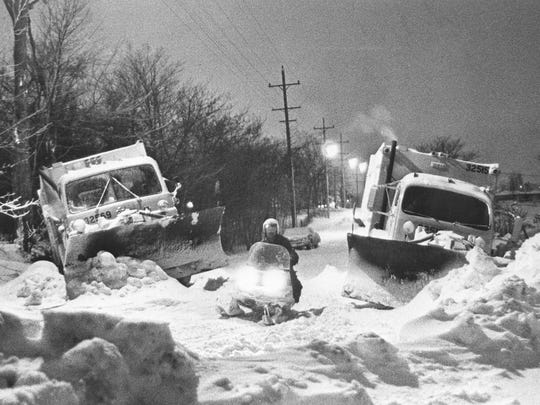 Forest Barnes passes two City of Milwaukee snowplows