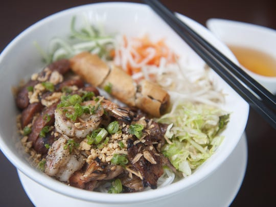 Rice vermicelli noodles are served with pork, shrimp, and spring rolls at Le Viet restaurant in Philadelphia.