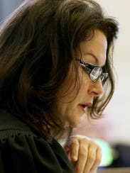 """Judge Leslie Ghiz reads what is known as the """"Allen"""