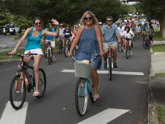 Bicycle riders of all ages and skill levels gather at the From the Ground Up Community Garden on North Hayne Street to take part in Bike Pensacola's Slow Ride series, Saturday, April 21, 2018. More than 300 riders took part in the roughly six-mile ride through the streets of downtown.