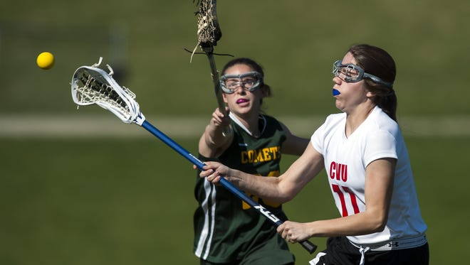 CVU's Annie Keen (11) takes a shot during the girls lacrosse game between BFA St. Albans and Champlain Valley Union on Thursday afternoon.