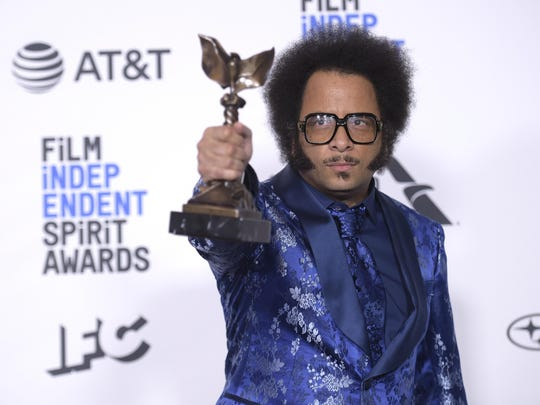 "Boots Riley poses in the press room with the award for best first feature for ""Sorry To Bother You"" at the 34th Film Independent Spirit Awards."