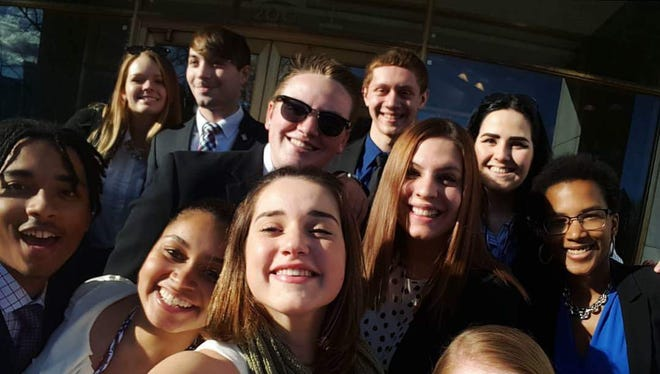 Lexi Franklin (center, wearing sunglasses) poses with fellow students during her trip to Washington, D.C.