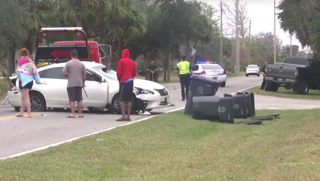 A person in a stolen car fled the scene of a crash on Park Avenue in Titusville Friday.