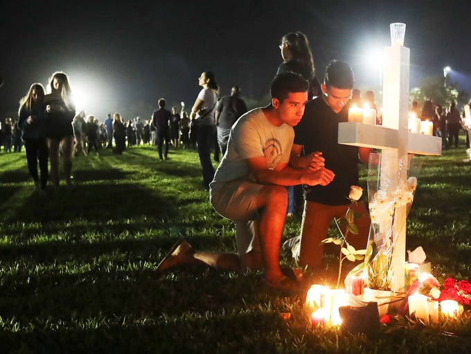 CARMEN SCHENTRUP. Mourners attend a candlelight vigil