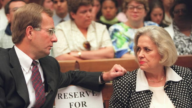 A.B. Culvahouse, former White House Counsel in the Reagan administration, left, talks to Jane Dannenhauer, former Officer of Personnel Security in the Ford to Clinton administrations, prior to testifying on Capitol Hill on June 19, 1996.