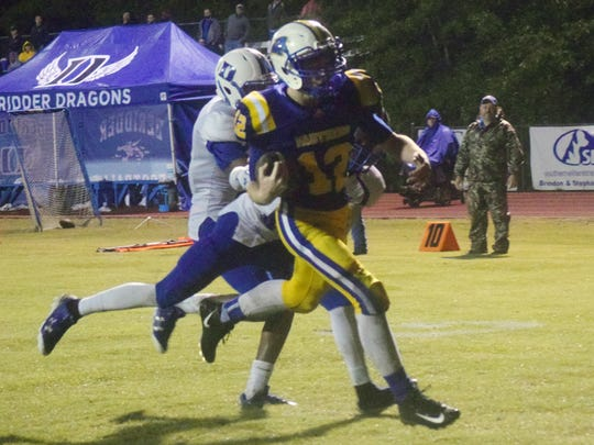 Buckeye High School's Nick Green (12) scores against DeRidder High School.