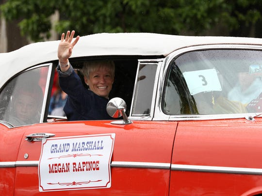 Olympic gold medalist and Palo Cedro native Megan Rapinoe waves to parade spectators in the 2016 parade in which she served as the grand marshal.