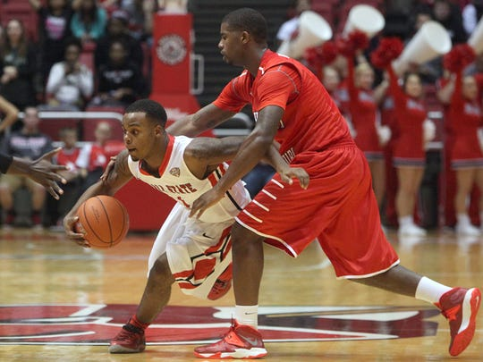 Ball State's Zavier Turner (Pike High School) fights past Southeast Missouri's defense during their game at Worthen Arena, Nov. 18, 2013.