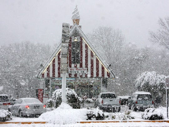 The first snow of the season blankets the Red Rooster