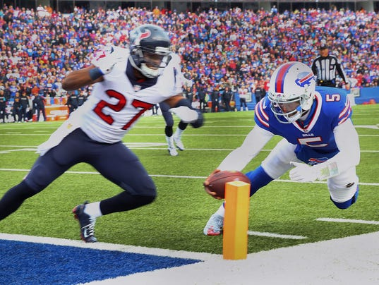 Bills quarterback tyrod taylor es for the end zone ahead of houston