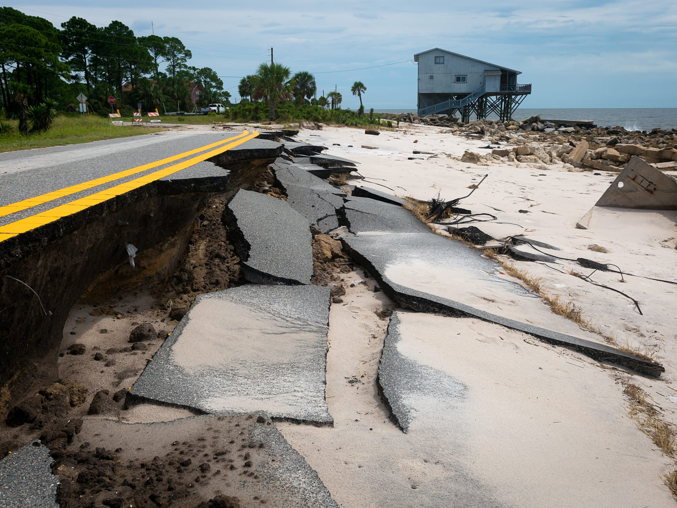 A road sits damaged from Hurricane Hermine in the Alligator
