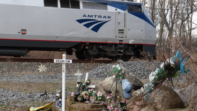 Memorial for Brandon Sauer, who died when he drove around closed gates at the King Road crossing in Chili and was struck by an Amtrak train. (February 2017 photo)