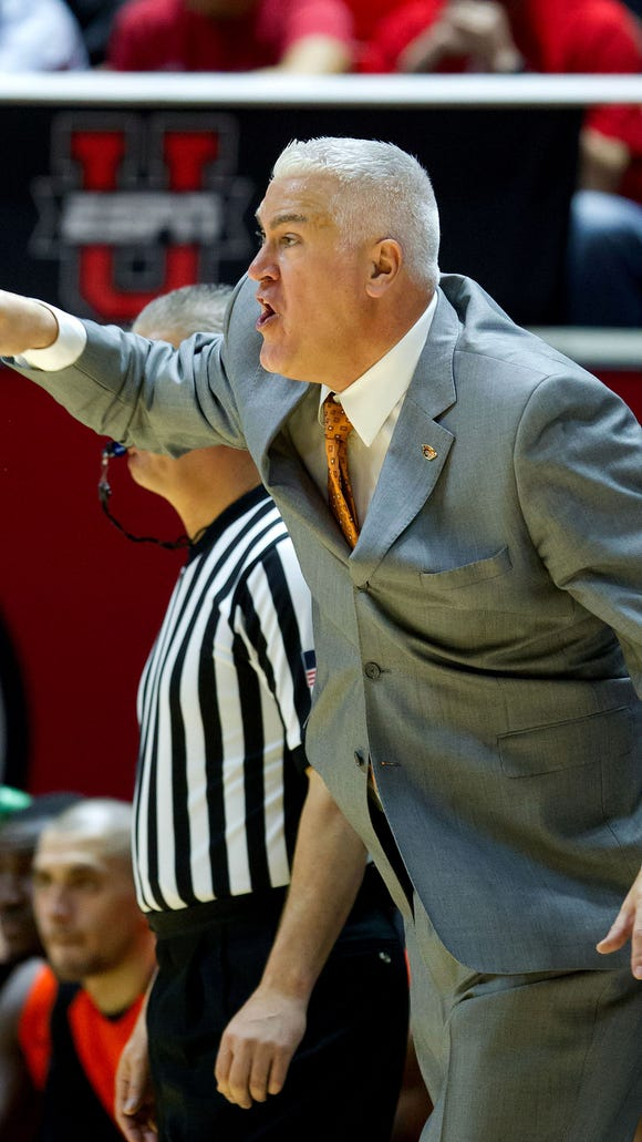 Oregon State men's basketball coach Wayne Tinkle reacts during the second half of Sunday's game at Utah.
