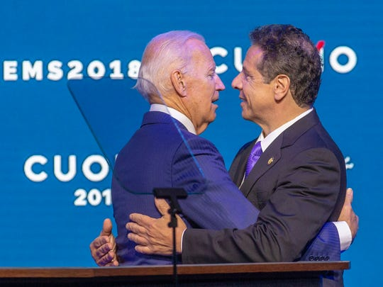"""Former Vice President Joe Biden, left, embraces New York Gov. Andrew Cuomo after endorsing Cuomo for reelection, on the opening day of the New York State Democratic Convention at Hofstra University in Hempstead, N.Y., Thursday May 24, 2018. In a forceful rebuke to President Donald Trump and other Washington Republicans, Biden told fellow Democrats that the GOP has abandoned traditional American values in the name of """"phony populism"""" and """"fake nationalism."""""""