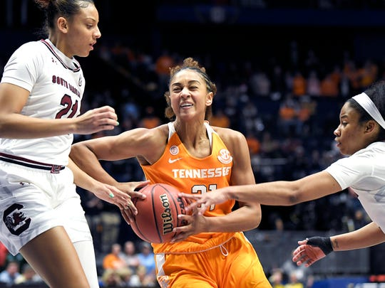 Tennessee Lady Volunteers forward Jaime Nared (31) drives to the basket against South Carolina Gamecocks forward Mikiah Herbert Harrigan (21) and South Carolina Gamecocks guard Tyasha Harris (52) during the quarterfinals at the 2018 SEC Women's Basketball Tournament  at Bridgestone Arena in Nashville on Thursday, March 2, 2018.