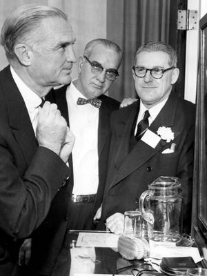 Senator W. Stuart Symington (D., MO), whose arrival was delayed by bad weather on Dec. 7, 1957, gave a final adjustment to his tie under the watchful eyes of J.T. Hayes (center) of Brownsville, past president  of the Tennessee Agriculture Council, and L.T. Barringer (right), local cotton man.