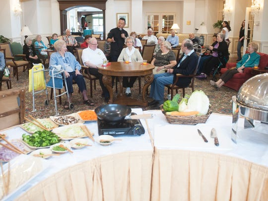Celebrity chef Jet Tila talks with residents of The