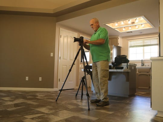 Ron Lute photographs a home in The Vineyard neighborhood