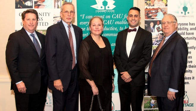 The honorees at the 2016 Gala of Community Access Unlimited were (center, left to right) Frank Guzzo, director of the Union County Department of Human Services; Lisa Taylor; and Ziad Shehady, business administrator of Springfield; flanked by Harold Poltrock (left), president of the CAU board of trustees, and Sid Blanchard, the agency's executive director.