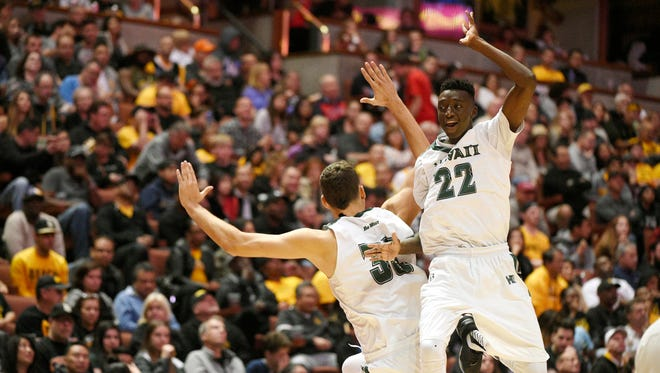 Hawaii guard Sheriff Drammeh, left, celebrates with forward Stefan Jankovic during their Big West championship win over Long Beach State.