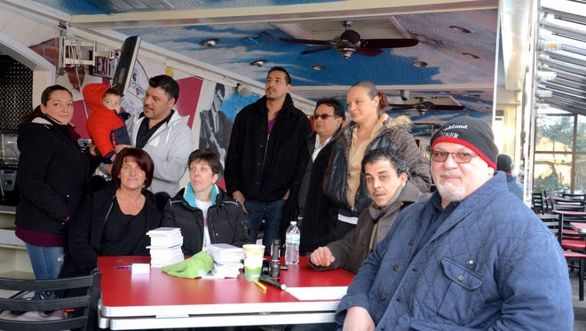 Oakland Diner owner Harry Mihas, right, with some of his employees, who helped him clean up after a fire last week.
