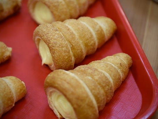 Fresh cream-filled pastries are ready for customers