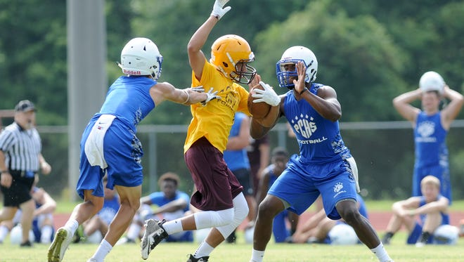 Polk County football players take part in a 7-on-7 scrimmage against Cherokee back in July.