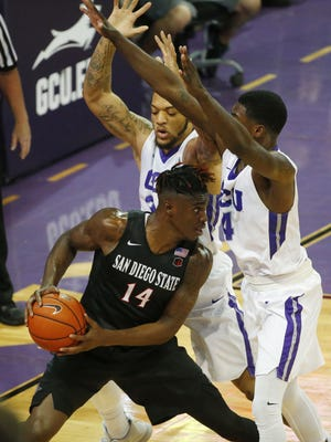 San Diego State forward Zylan Cheatham (14) looks to pass between Grand Canyon University forward Keonta Vernon (24) and forward Oscar Frayer (4) during the second half at GCU Arena in Phoenix, Ariz. December 7, 2016.