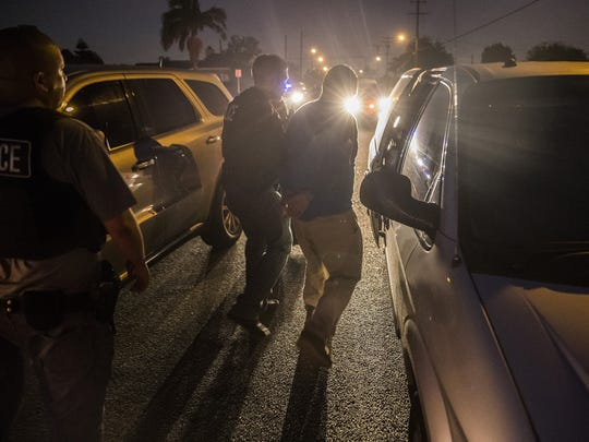 This file photo shows Immigration and Customs Enforcement agents taking a man into custody on April 18, 2017 in Downey, Calif.