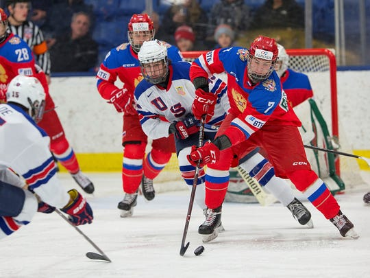 Andrei Svechnikov (7), considered the No. 2 prospect in the 2018 NHL Entry Draft, carries the puck for Russia against the U.S. during Friday's Five Nations tourney game.