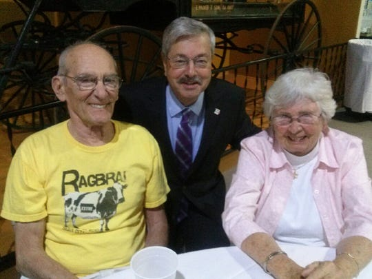 John Karras, left, met with Gov. Terry Branstad on Thursday night at the official opening of the RAGBRAI exhibit at the State Historical Building. Karras, pictured with his wife, Ann, is a former Des Moines Register columnist who was part of the tandem that founded and rode the original RAGBRAI.