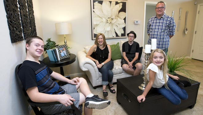 Lennar Dusk Super Next Gen model at The Bridges at Gilbert  includes a main house and an attached full private suite. The Leydons purchased a Next Gen home so that their special needs son, Jordan, can live with them for many more years. Jordan Leydon, 16; his mother, Christine; brother, Brandon, 14; father, Edward; and sister Jada, 7, visit the Lennar model while their new home is under construction.