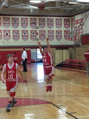 Robbie Alonso warms up before a freshman basketball game at Tappan Zee High School.