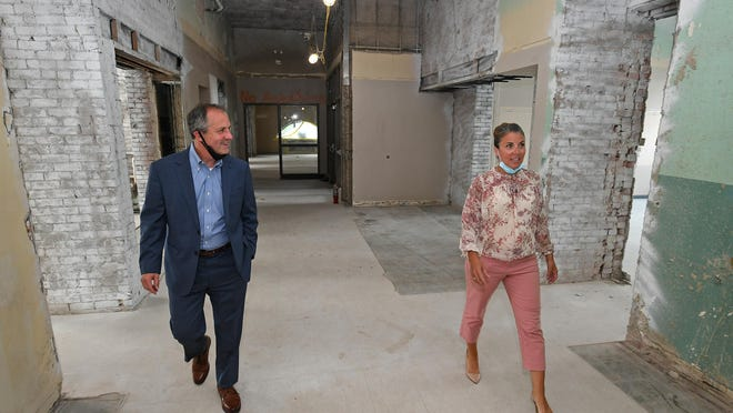 "Charles ""Boo"" Hagerty and Daria Devlin walk through the first floor of the former Wayne School, 650 East Ave., on Thursday. This 16,500-square-foot-space is being renovated into studios and classrooms for the Erie Center for Arts and Technology, which owns the 80,180-square-foot building. Hagerty is president of the Hamot Health Foundation, which is an investor in ECAT, and is the ECAT board chairman. Devlin is the executive director of ECAT."