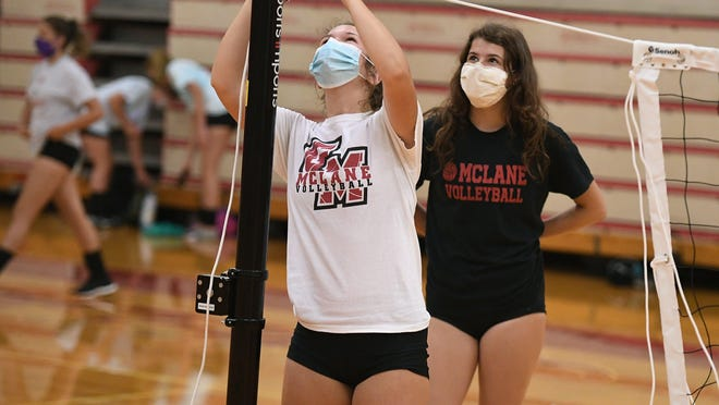General McLane volleyball teammates Jenna Kulka, 17, foreground, and Ellen Cunningham, 16, set up a net July 9, 2020, prior to a workout. The PIAA is permitting fall sports teams to begin official practices Monday.