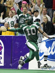 Robert Garth strides downfield for a touchdown after recovering a fumble against the Manchester Wolves in 2009, which was the Green Bay Blizzard's last year competing in arenafootball2. Garth played for the team throughout its seven years in af2.