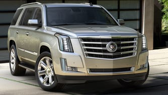 The 2015 Cadillac Escalade full-size SUV is a money-maker for GM and is among many new models GM will have introduced within a short period.