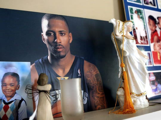 June 26, 2015 - Photos of Lorenzen Wright displayed in the home of Deborah Marion, Lorenzen's mother.