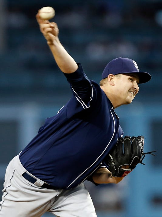 San Diego Padres starting pitcher Trevor Cahill throws to a Los Angeles Dodgers batter during the first inning of a baseball game in Los Angeles, Wednesday, April 5, 2017. (AP Photo/Alex Gallardo)