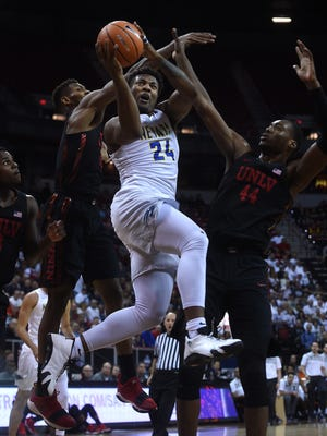 Nevada's Jordan Caroline (24) drives to the basket while taking on UNLV during the Mountain West Men's Basketball Championships at the Thomas & Mack Center in Las Vegas on March 8, 2018.