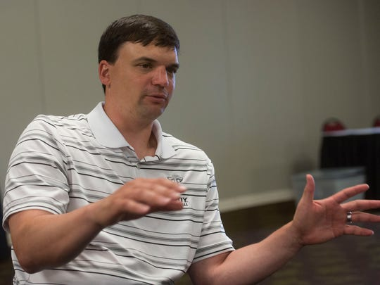 Troy University's head football coach, Neal Brown, talks about his team's upcoming season during an interview at New World Landing Thursday.
