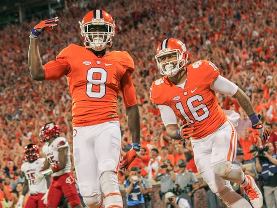 Clemson wide receiver Deon Cain (8) celebrates his second-quarter touchdown against Louisville with teammate Jordan Leggett on Oct. 1 at Memorial Stadium in Clemson.