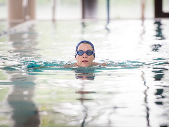Melanie Passon, of Milton, swims laps at the University of West Florida pool in Pensacola on Tuesday, September 5, 2017.  Passon and Emily Bailly are training to go to Nepal in October to climb to Mount Everest base camp.