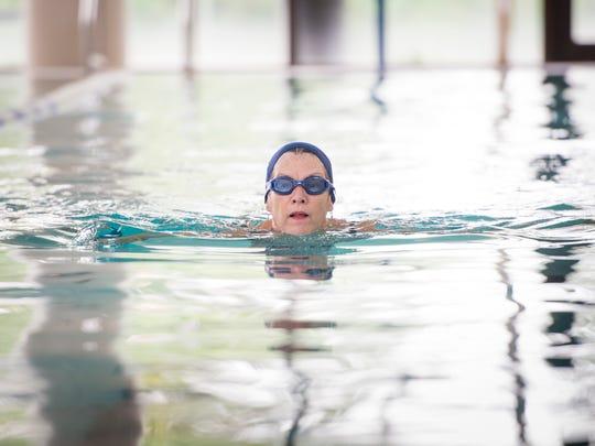 Melanie Passon, of Milton, swims laps at the University