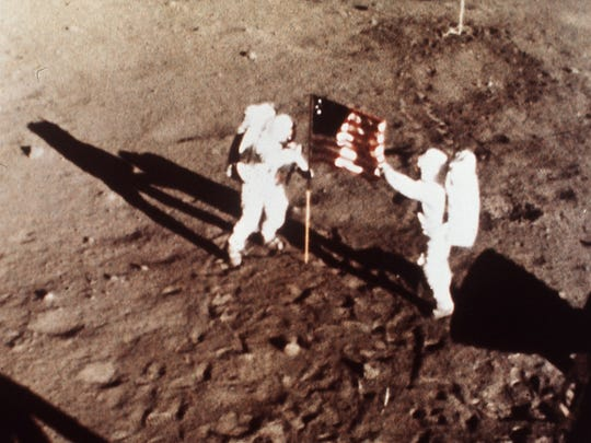 "In this July 20, 1969 file photo provided by NASA shows Apollo 11 astronauts Neil Armstrong and Edwin E. ""Buzz"" Aldrin, the first men to land on the moon, plant the U.S. flag on the lunar surface. The family of Neil Armstrong, the first man to walk on the moon, says he has died at age 82. A statement from the family says he died following complications resulting from cardiovascular procedures. It doesn't say where he died. Armstrong commanded the Apollo 11 spacecraft that landed on the moon July 20, 1969. He radioed back to Earth the historic news of ""one giant leap for mankind."" Armstrong and fellow astronaut Edwin ""Buzz"" Aldrin spent nearly three hours walking on the moon, collecting samples, conducting experiments and taking photographs. In all, 12 Americans walked on the moon from 1969 to 1972.  (AP Photo/NASA)"