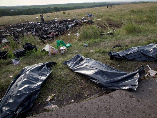 malaysia ukraine plane bodies