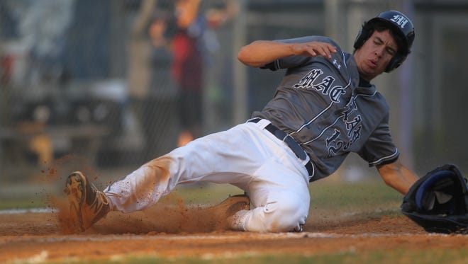 Maclay senior Matt Boynton slides safely into home on a play at the plate.