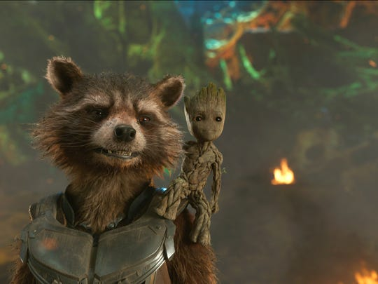 """This image released by Disney shows the Rocket, voiced by Bradley Cooper, left, and Groot, voiced by Vin Diesel in a scene from Marvel's """"Guardians Of The Galaxy Vol. 2."""""""